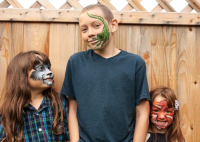 Three kids painted-faces Christine White Artit